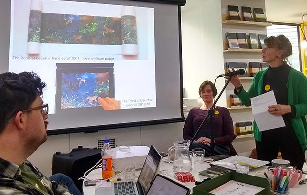 Artist Helen Douglas talking at an event