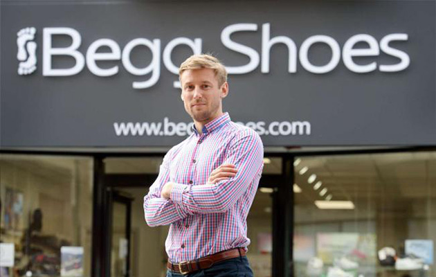 Donald Begg in front of Begg Shoes shop